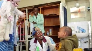 Fekat Circus performers visit a hospital in Addis Ababa as part of the Smile Medicine Project.