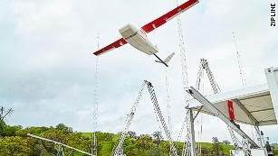 A Zipline drone launches from a distribution center. It will deliver blood or vaccines to its destination within 30 minutes.