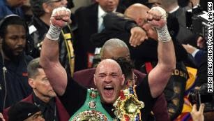 British boxer Tyson Fury celebrates after defeating US boxer Deontay Wilder in the seventh round during their World Boxing Council (WBC) Heavyweight Championship Title boxing match at the MGM Grand Garden Arena in Las Vegas on February 22, 2020.