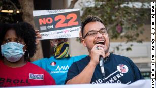 A Gig Workers Rising demonstrator speaks during a protest against Californi's Prop. 22 in 2020.
